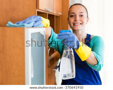 Cheerful female cleaner making cleaning in the office-room   - stock photo