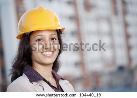 Cheerful female construction engineer - stock photo