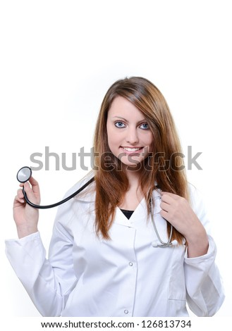 Cheerful female doctor with stethoscope isolated over a white background - stock photo