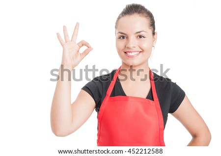 Cheerful female employee on supermarket doing ok sign as great sales concept isolated on white background - stock photo