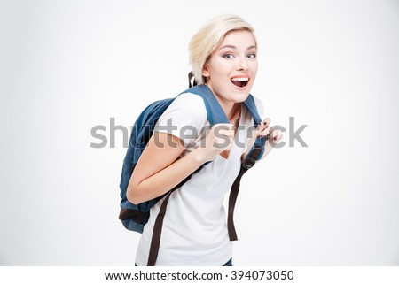 Cheerful female student standing isolated on a white bakground and looking at camera - stock photo
