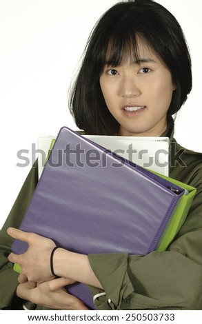 Cheerful female student with notebooks