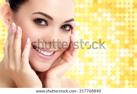 Cheerful female with fresh clear skin, bright background with circles