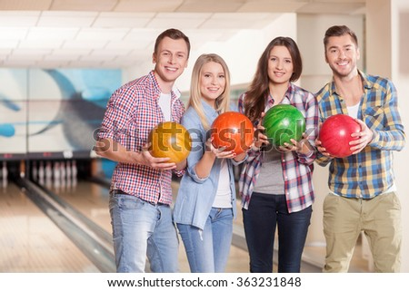 Cheerful four friends are ready to play kegling - stock photo