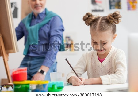 Cheerful friendly family is painting together