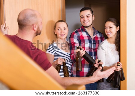 Cheerful friends gathering together at house booze party - stock photo