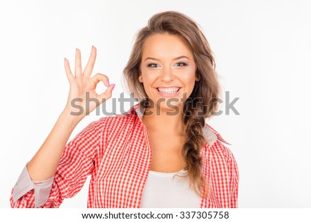Cheerful funny cute girl gesturing ok - stock photo