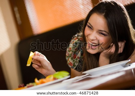 Cheerful girl at table