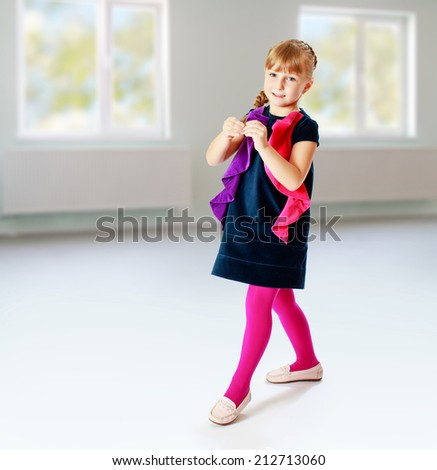 cheerful girl cheerfully walks through the room.The concept of development of the child younger years. - stock photo