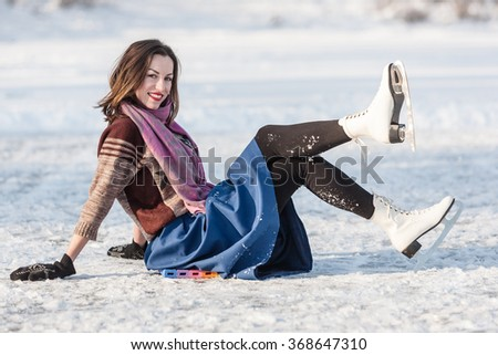 Cheerful girl having fun in winter ice skating. Winter sport and leisure concept. - stock photo
