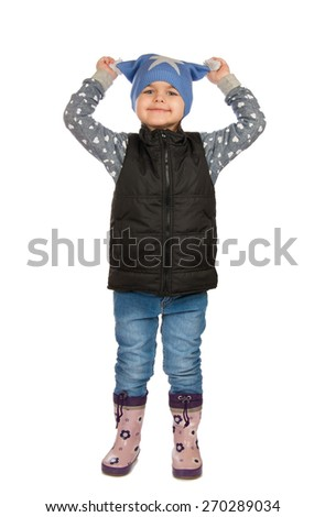 cheerful girl holding himself for his hat. Isolation on a white background - stock photo