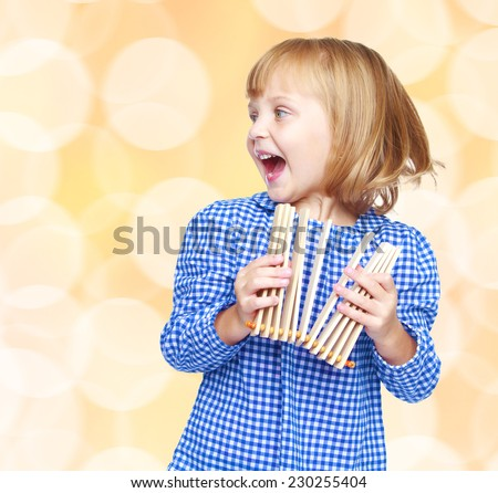 Cheerful girl in a blue plaid shirt.charming little girl - stock photo