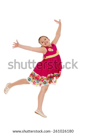 cheerful girl in a jump, hands wide apart - isolated on white. - stock photo