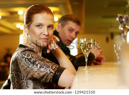 Cheerful girl in the restaurant and a man flirting with her - stock photo