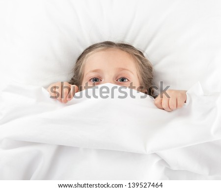 cheerful girl in white bed - stock photo