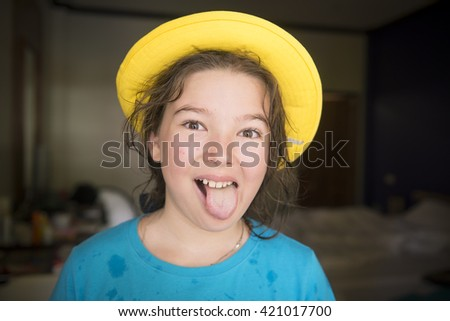 Cheerful girl in yellow cap - stock photo