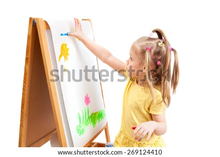 Cheerful girl is drawing by painted bright colors - stock photo