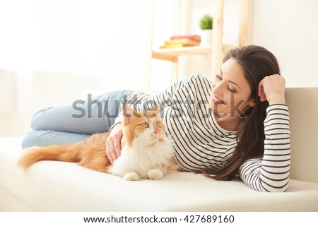Cheerful girl is enjoying time at home - stock photo