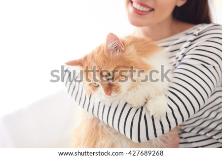 Cheerful girl is having rest with pet - stock photo