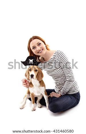 Cheerful girl is playing with her dog - stock photo