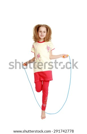 Cheerful girl jumping rope - isolated on white background - stock photo