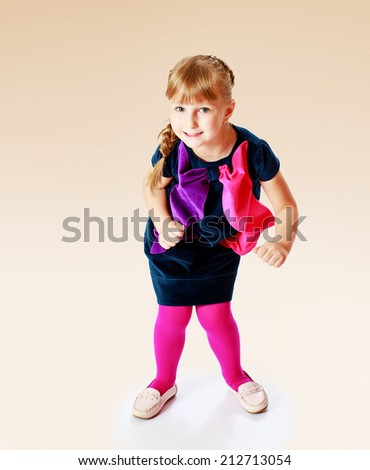 cheerful girl jumping.The concept of development of the child younger years. - stock photo