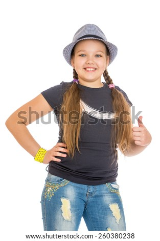 cheerful girl of school age with a hat and jeans - isolated on white. - stock photo