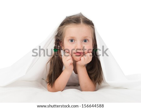 cheerful girl portrait in white bed - stock photo