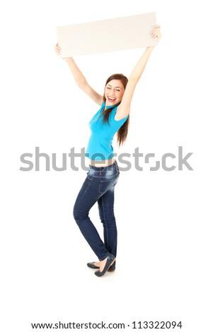 cheerful girl presenting something, full length, white background - stock photo