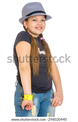 Cheerful girl schoolgirl in a hat and pureed jeans-Isolated on white background - stock photo