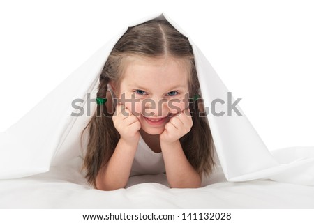 cheerful girl under the blanket - stock photo