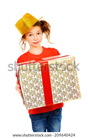 Cheerful girl wearing party hat holding big box with a present. Isolated over white. - stock photo