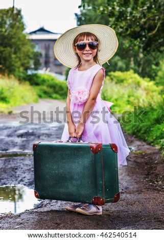 Cheerful girl with a suitcase.