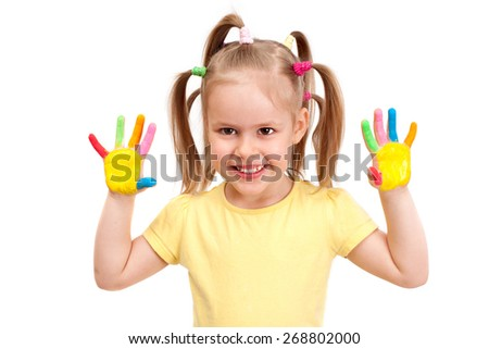 cheerful girl with painted bright colors palms - stock photo