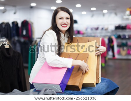 cheerful girl   with shopping bags  at clothing shop - stock photo