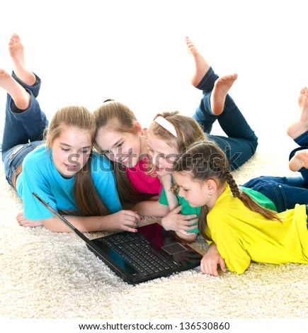 cheerful girlfriends with laptop on white background - stock photo