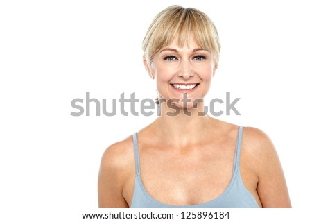 Cheerful glamorous fashionable woman facing camera with a smile. - stock photo