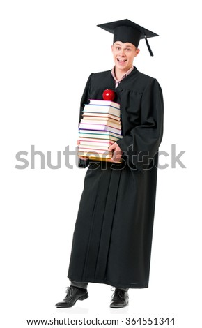Cheerful graduate guy student in mantle with books and apple, isolated on white background - stock photo