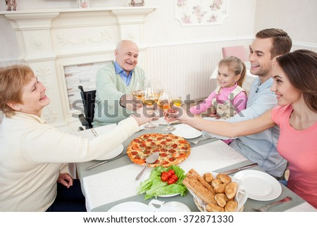 Cheerful grandparents are celebrating event with children
