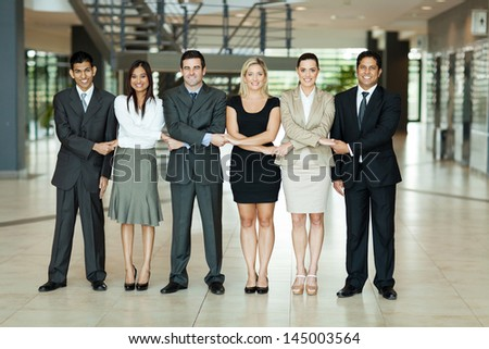 cheerful group of business people holding hands - stock photo