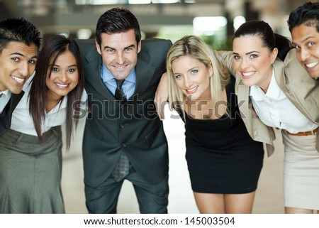 cheerful group of business people huddling - stock photo