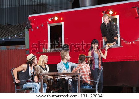 Cheerful group of customers with pizza orders from canteen - stock photo