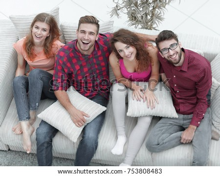 cheerful group of friends laugh ,sitting on the couch. the concept of friendship.