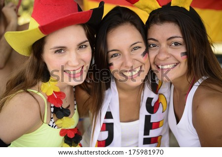 Cheerful group of German women soccer or football sport fans. - stock photo