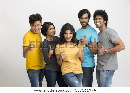 Cheerful group of Indian young friends on a white background. - stock photo