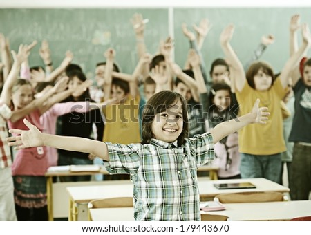 Cheerful group of kids at school room having education activity - stock photo