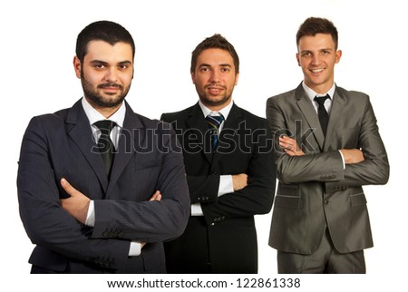 Cheerful group of three business men standing with arms folded in a line isolated on white background