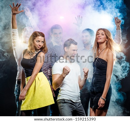 Cheerful group of young people dancing at party  - stock photo