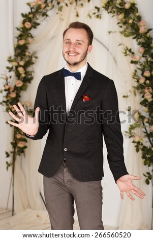 cheerful guy in a classic suit and bow tie - stock photo