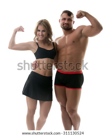 Cheerful handsome athletes showing biceps